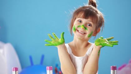 Child painting in the kindergarten